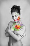 Girl with flower body art. Black and white. Partly color Royalty Free Stock Photography