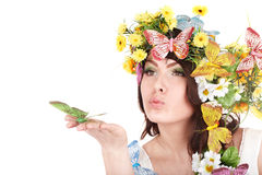 Girl with flower and  butterfly on hand. Royalty Free Stock Images