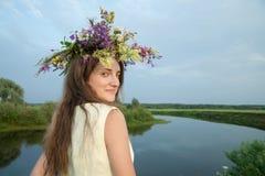 Girl  in flower chaplet Royalty Free Stock Images