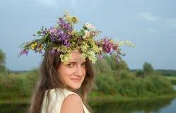 Girl  in flower chaplet Royalty Free Stock Photo