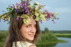 Girl  in flower chaplet. Long-haired teen girl  in flower chaplet against river Stock Photography