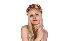 Girl with flower chaplet on her head Stock Image