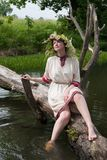 Girl in flower chaplet at river stock photo
