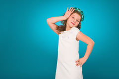 Girl with flower decorations. White dress. Turquoise background. Royalty Free Stock Images