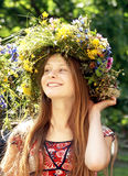 Girl with flower diadem Royalty Free Stock Image