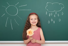 Girl with flower draw sun and cloud on board Stock Photo