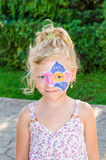 Girl with flower face painting Royalty Free Stock Images