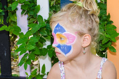 Girl with flower face painting Stock Image