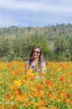 Girl in flower field Royalty Free Stock Photo