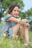 Girl in a flower field Stock Images