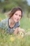 Girl in a flower field. Portrait of a girl daydreamming in flower field stock images