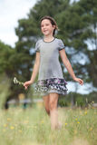 Girl  in a flower field Royalty Free Stock Photo