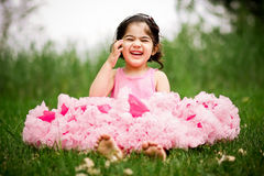 Girl in flower garden Stock Photography