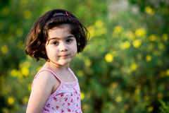 Girl in flower garden Stock Photo