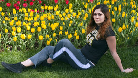 Girl flower garden sit down Royalty Free Stock Photos