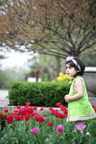 Girl in flower garden2 Royalty Free Stock Photography