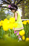 Girl in flower garden7 Stock Image