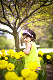 Girl in flower garden9 Royalty Free Stock Photos
