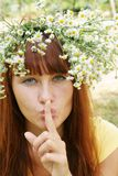 Girl in flower garland Stock Photography