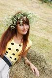 Girl in flower garland Royalty Free Stock Photos
