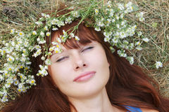 Girl in flower garland Royalty Free Stock Images