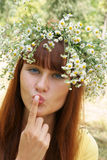 Girl in flower garland Stock Images