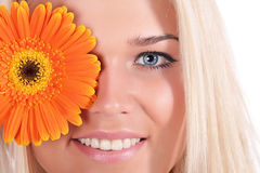 The girl with a flower Gerbera Stock Photography