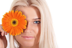 The girl with a flower Gerbera Royalty Free Stock Images