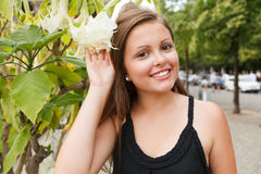 Girl with a flower. Gives a smile Stock Image