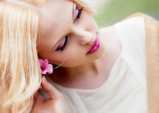 Girl with flower in hair Stock Images
