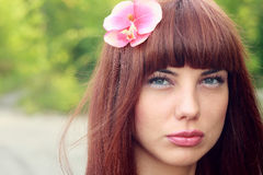 Girl with flower in hair Royalty Free Stock Photography