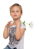 Girl with flower in hand Royalty Free Stock Photo