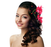 Girl with flower in her hair Stock Image