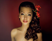 Girl with flower in her hair Stock Photography