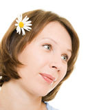 Girl with flower in her hair. Stock Photos