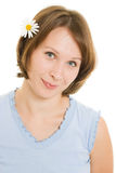 Girl with flower in her hair. Stock Photography