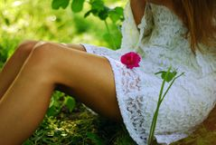 Girl with flower on her legs Royalty Free Stock Photography