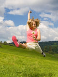 Girl with flower jump Royalty Free Stock Photography