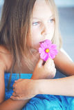 Girl with a flower Royalty Free Stock Images