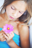 Girl with a flower Royalty Free Stock Photography