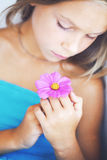Girl with a flower Stock Image