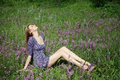 Girl on flower meadow Stock Photos