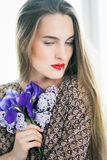 Girl with flower in mouth Stock Image