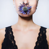 Girl with flower in mouth Stock Photo
