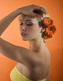 Girl with flower posing Royalty Free Stock Image