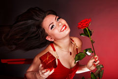 Girl with flower rose and gift box running. royalty free stock photography