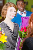 Girl in Flower Shop Purchases Roses Royalty Free Stock Photo