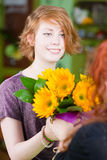 Girl in Flower Shop Purchases Sunflowers Stock Photos