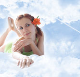 Girl with flower on sky Royalty Free Stock Photography