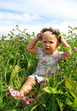 Girl in a flower wreath. Beautiful girl in a flower wreath Royalty Free Stock Photos